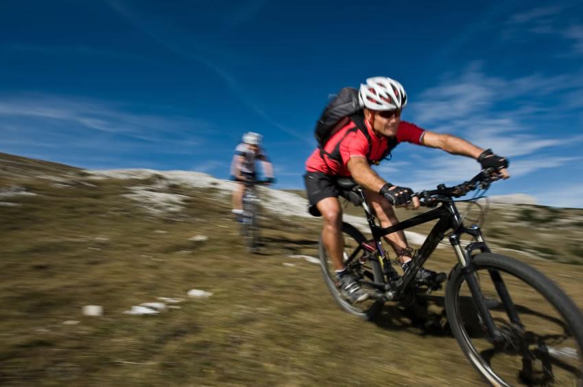 mountain bikers going down hill